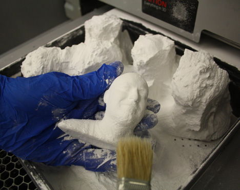 Cleaning off excess powder-SLS