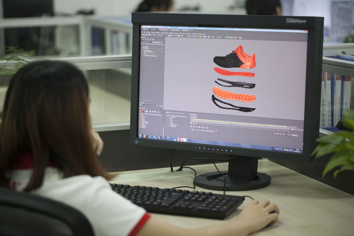 Designer is working on 3D model of the sneaker